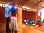 Paul preaching and Sarah translating in the Buvuma Islands, Uganda