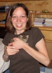 Holding Minnie when she was a kitten in June 2009.