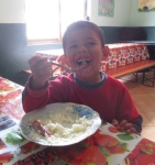 One of the boys enjoying his lunch.