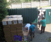 Bringing food parcels into the YWAM base.